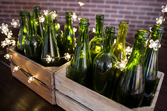Green wine bottles sorrounded with tiny lights