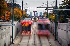 On Track (Paul Flynn (Toronto)) Tags: streetcar track rail transit public ttc toronto commission fall autumn spadina avenue street traffic transportation red nd filter long exposure
