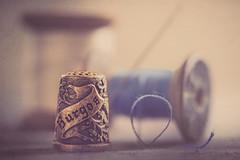 Old thimble (Ro Cafe) Tags: mm macromonday souvenir macro sewing tools threads needle thimble spools selectivefocus softfocus blur nikkormicro105f28 nikond600 textured