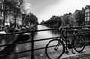 Channel - _DSC2144-Editar (Elbier Minks) Tags: amsterdam bicicleta bycicle bw bn canal channel water agua city ciudad puente baranda boats barcos rio