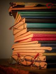 Memoirs (KnightedAirs) Tags: nikon nikkor d5200 afs 60mm digital memoir memoirs journals glasses eye reading bookmark book stack wood depth field bokeh moody lighting shadow sb400 flash external