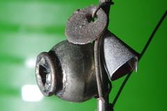 Berimbau Fridge Magnet From Bahia (erluko) Tags: macromondays souvenir strobe flash berimbau instrument musical magnet macro brasil brazil bahia salvador musica capoeira dust wiredflash refrigeratormagnet light green silver