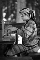 Weaving (..ChEn..) Tags: people girl woman taiwan culture weave weaver working concentration focus traditional performing performer teaching demonstration clothing 紡織 九族