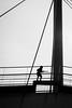 Tiny trooper 小小士兵 (The Curious Observer) Tags: bw bnw blackandwhite candid streetphotography kid child gun silhouette sky outdoor bridge lines 剪影 黑白 紀實 街頭 小孩