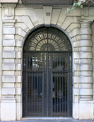 Artistic license: An asymmetrically framed doorway in Barcelona (Spencer Means) Tags: dwwg door doorway arch arched column frame entrance portal iron ironwork glass stone carved sculpted asymmetry asymmetrical modernista modernisme dreta eixample barcelona catalonia catalunya spain