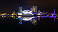 Calm summer nights at the Quays (G-WWBB) Tags: lowrysalfordquays lowry lowrybridge lowrytheatre theatre quays mediacityuk mediacity alchemist bridge footbridge liftbridge salfordquays salfordquaysliftbridge salfordquaysmillenniumfootbridge waterfront water waterside reflections reflect reflecting night longexposure lights purple blue pink