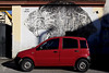 Red and Black (Giovanni Cappiello | f.64) Tags: black white steel morning wall yellow rough elogiodellombra urban transport rome car watermark street gray shadow mural old cement red iron roma