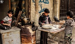"""All sorrows are less with bread."" (Take a look on Syria without propaganda) Tags: syria damascus syrian story siege street children child childhood civilians conflict civil cold city bread regime iran iraq work سوريا سوريين سوري طفل طفولة أطفال الأسد الأطفال خبز عمل حصار شوارع شارع دمشق الغوطة gouta gota eastern"