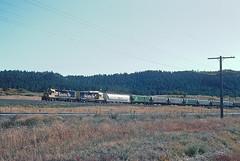 AT&SF GP38u 2310 north of Palmer Lake, CO on October 3, 1992. She became BNSF 2200. (railfan 44) Tags: atsf santafe