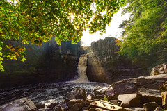 The sun shines when I least expect it (Andrew Laws) Tags: sun light sunstar clouds nikon d5500 dslr camera outdoors 1855mm rocks stones nature naturaleza sol trees arbol leaves hojas water agua waterfall cascada autumn autumnal otoño landscape scenery color