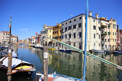 The Grand Canal of the island of Chioggia (B℮n) Tags: chioggia veneto lagoon island cathedrale fishmarket harbor fishing port pace life italië italia italy ronams clodia seafood panorama panoramico boat ships tour locals canals boats unspoiled bridgde town colors tourism vacation holiday summer architecture historic authentic canal vena bridge historical