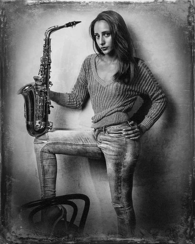 White Sexy black aand player girl saxophone