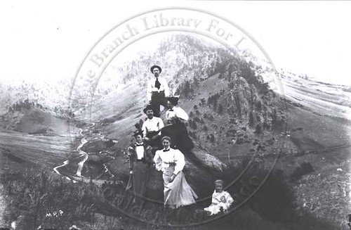 Photo - A group posed above Sunshine Canyon (1897-1910).
