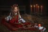 Piccola ricamatrice (Katia Pedroni) Tags: bellezzarussa tipicovestitorusso sarafan vestitorosso emozioni bambina ritratto nikond5500 child kids baby fienile candele melerosse