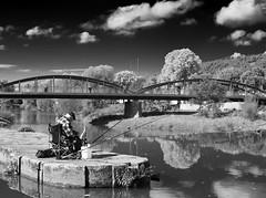 The lonely Fisherman (Frank KR) Tags: street streetart streetinbw hessen germany deutschland bnw blackandwhite river fisherman fisher fischer angler angeln brücke bridge fulda fluss autofocus