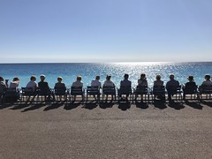 Watching the beach and the ocean in Nice, France. (Sander Pot) Tags: streetphotography beachfront horizontal poster frankreich frankrijk seats chairs sea méditerranée skyline bluesky row sitting people chair côtéd'azur france nice boulevard ocean beach
