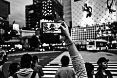 Shibuya Framed (Victor Borst) Tags: street streetphotography streetlife reallife real realpeople asia asian asians faces face fuji fujifilm blackandwhite bw facesoftokyo tokyo shibuyacrossing smartphone photographer phone photography mono monotone monochrome urban urbanroots urbanjungle japan japanese city cityscape citylife