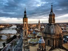 El Pilar desde la torre Oeste (Antonio Goya) Tags: elpilar zaragoza españa spain atardecer sunset clouds nubes skyline ebro puente rio river basilica olympus omd dng micro43 dzoom xataca