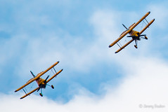Breitling (JKmedia) Tags: wing walker women boultonphotography plymouth 2017 armedforcesday flying aircraft biplane areobatics smoke display breitling orange grey day daring