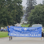 "<b>Homecoming Parade</b><br/> Here SAC members march with a banner supporting the parade. Saturday morning the Homecoming Parade commenced. The parade was put on by SAC, Student Activities Council. Photo Taken By: McKendra Heinke Date Taken: 10/7/17<a href=""http://farm5.static.flickr.com/4484/37755940191_3bbc3dbfae_o.jpg"" title=""High res"">∝</a>"