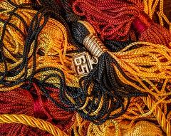 Ancient Artifacts (Wes Iversen) Tags: hsos macro smileonsaturday tokina100mmf28atxprod black cardinal cords gold graduation honorcords objectsofsentimentalvalue personal remembrances tassels