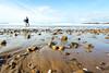 Wet Look (NVOXVII) Tags: beach coast bude sand waves surfer bodyboarder bluesky washedout filmlook lowdown perspective canon tones pebbles rocks seascape cornwall kernow uk autumn october overexposed bright fade dof depthoffield