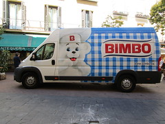 Bread Delivery (RubyGoes) Tags: spain blue white dog madrid balconies restaurant potplant tree green windows red logo awning cafe chairs people van delivery mercedes