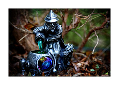 The Healing Potion (paulinecurrey) Tags: halloween macromondays spooky wizard dragon couldron potion crystle liquid smoke magic mystical mood textures bottles ladle autumn woodland leaves digital camera ornament photoshop metal blur bokeh