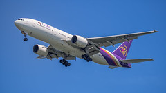 Thai Airways B777-300 HS-TJC (Anthony Kernich Photo) Tags: singapore changi airport changibeach airplane aircraft airplanepicture airplanephotograph airplanephoto plane aviation jet olympusem10 olympus olympusomd commercialaviation planespotting planespot aeroplane flight flying airline airliner widebody thai thaiairways hstjc boeing boeing777 b777 b777300er landing