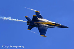 Blue Angels F-18 Hornet (KGrif_) Tags: fly flight fighter f18hornet navy blueangels bomber vaportrail weapon war warbird wings takeoff tail transportation airshow airplane aerial aircraft attack above aviation sky speed soar stunts launch landing huntingtonbeach engine jet jetengine pilot canopy exhaust event smoke