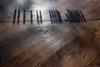 l'ombra delle mollette sul tavolo (Clay Bass) Tags: 1030 monforte clothespins nikon1 shadow table