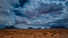 Monumental clouds (marcomariamarcolini) Tags: nikon nikkor usa america landscape huge small nature clouds colorful colors red green yellow blue depthoffield emotional wow digital reflex camera highresolution detail sharpness sharp bigsize infinite view viewpoint panorama ngc unitedstatesofamerica unitedstates wilderness wild skyline sky tree light cloud shadows marcomariamarcolini rain storm stormy