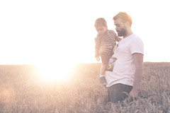 Daddy and son in the sunset