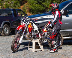 Dressed To Race (John Kocijanski) Tags: people motorcycle dirtbike vehicle rider race sport racer hondacr500 red canon70300mmllens canon7d candid streetphotography streetcandid hillclimb