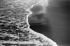 FILM - On the edge of the world-1 (fishyfish_arcade) Tags: analogphotography bw beach blackwhite blackandwhite filmphotography filmisnotdead fulifilmacros100 istillshootfilm mablethorpe monochrome nikkor50mmf18sfd nikonf70 seaside analogcamera film mono waves sea
