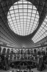 Lines and Curves (Vertical) (magpiedom) Tags: leeds corn exchange curves lines shopping black white bw tokina tripod nd400 hoya nikon 1120mm f28 high grand vaunted stairs coffee rest clock architecture people building arch window atrium ceiling