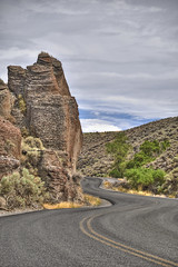 Stentorian (El Justy) Tags: idaho pacificnorthwest unitedstates pnw usa balancedrock landscape road sky clouds scenery summer outdoors travel photography photo justinrice rocks street windy gemstate hills grass roads