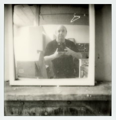 PolaCon Selfie (tobysx70) Tags: the impossible project tip polaroid slr680 frankenroid sx70 door rollers bw blackandwhite film for 600 type cameras instant impossaroid polacon selfie norman roscoe evers hardware building west hickory street denton texas tx self portrait man mirror camera black tshirt coat hanger polacon2017 polacontwo 093017 toby hancock photography