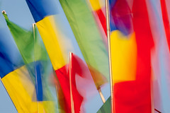 Western Fair Flags (josullivan.59) Tags: wallpaper 3exp evening texture tamron150600 telephoto ontario outside artistic day detail downtown fall goldenhour london canon6d canada clear blur midway fair westernfair colors flag longexposure red yellow blue green september 2017