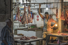 Serious business (Christoph H-P) Tags: meat butcher serious market asia brutality