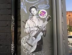 Toronto 2017 (bella.m) Tags: voteana music harmonica thismachinekillsfascists woodyguthrie graffiti streetart urbanart toronto canada art wheatpaste pasteup guitar