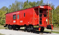 Lake, Michigan (2 of 4) (Bob McGilvray Jr.) Tags: lake michigan nkp nickelplateroad nw norfolkwestern caboose red steel baywindow display public static railtrail railroad train tracks