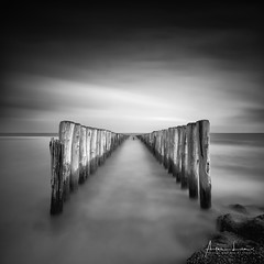 Double The Row III (Alec Lux) Tags: bw breskens beach blackandwhite blackandwhitephotography breakwater coast coastline groyne landscape landscapephotography longexposure longexposurephotography nature naturephotography netherlands ocean rocks scenic sea seascape seascapephotography sky smooth stones water waves zeeland nl