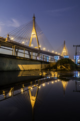 Reflection of Bhumibol Bridge (TOYTOMORN) Tags: bhumibol bridge สะพานภูมิพล ประเทศไทย สมุทรปราการ wide wideangle water weatherphoto outdoor 18mm 18105 selp18105g nightscape night nightphoto nightscene nighttime view river province amateur angle asia asian architecture afterdark a6500 alpha apsc apcs adulyadej mirrorless mount photo photographer photography pics muangsamutprakan samutprakan blue building bluehour bangkok beautiful sky skies landscape landscapes landmarks lightnight light lights long reflection earth