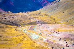Tourists climbing and descending toward Asungate mountain.