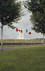 Vimy: Memorial with Flags (McFarlaneImaging) Tags: 100 2015 35mm a1 asa100 analog battlefield canada canadian canadiannationalvimymemorial canon ektar europe eurotrip fd film flags france french fromage greatwar iso100 kodak lestweforget mci memorial monument northern remember slr travel vacation vimy vimyridge ww1 westernfront worldwarone mcfarlaneimagingcom