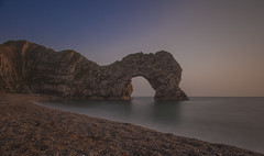 Durdle Door (Kam Sanghera) Tags: seaside uk england britain kingdom united jurassic shingle beach rock coast hour golden lulworth west durdle door dorset canon eos 5d mark ii limestone 10 stop nd filter nd10 stopper seascape 20mm f28 ef ef20mm usm arch sunset twilight