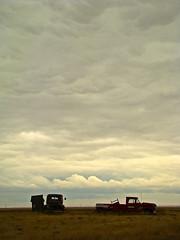 robsart parking (skylinejunkie) Tags: robsart saskatchewan ghosttown cloudy sky abandoned rusted rusty car truck prairie fall autumn negativespace grassland canada rural decay