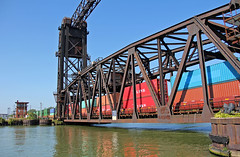 Stack Train at Drawbridge (craigsanders429) Tags: cleveland cuyahogariver nschicagoline stacktrains nsstacktrains water waterways rivers norfolksoutherntrains norfolksouthern railroadbridges