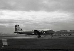 G-APEZ. Starways Douglas DC-4-1009 (Ayronautica) Tags: ayronautica aviation propliner prestwick pik egpk scanned dc4 gapez starways douglasdc41009 airliner january 1961